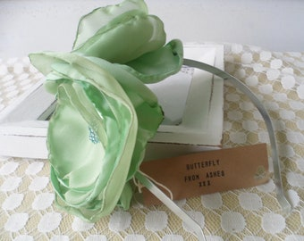 Double rose spearmint green handmade flower fasinator for bridesmaids, wedding, prom,spring races, day and evening
