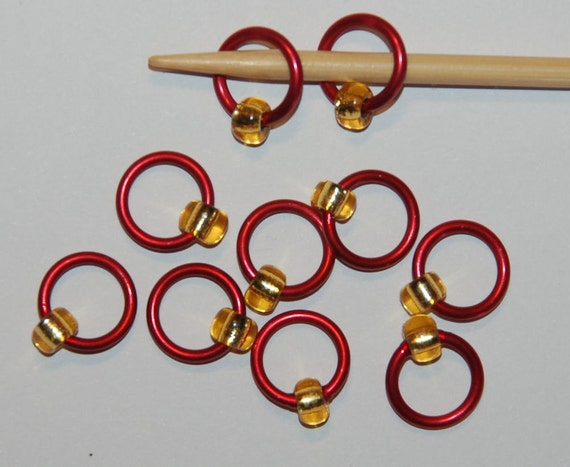 XL silver lined topaz on red stitch markers