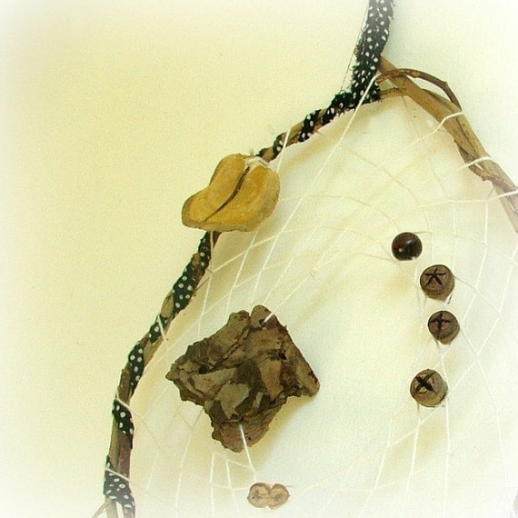 Baby mobile dreamcatcher white weave with tree bark, natural pods, beads, metallic bell and a large feather