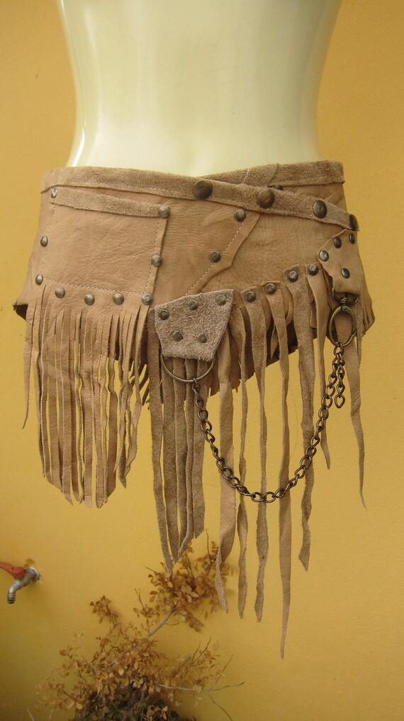 BURNING MAN..natural leather skirt/belt with pocket, stud detail,D ring and chain....small