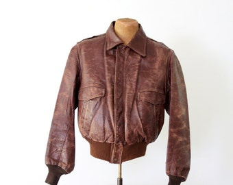 1950s bomber jacket, vintage brown leather jacket
