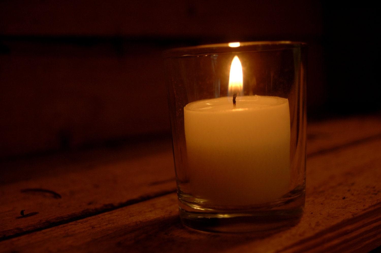 clear glass votive holder with white unscented votive candle. Black Bedroom Furniture Sets. Home Design Ideas