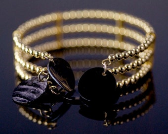 Triple Strand Memory Wire Bracelet with Gold Beads & Black Shell Beads