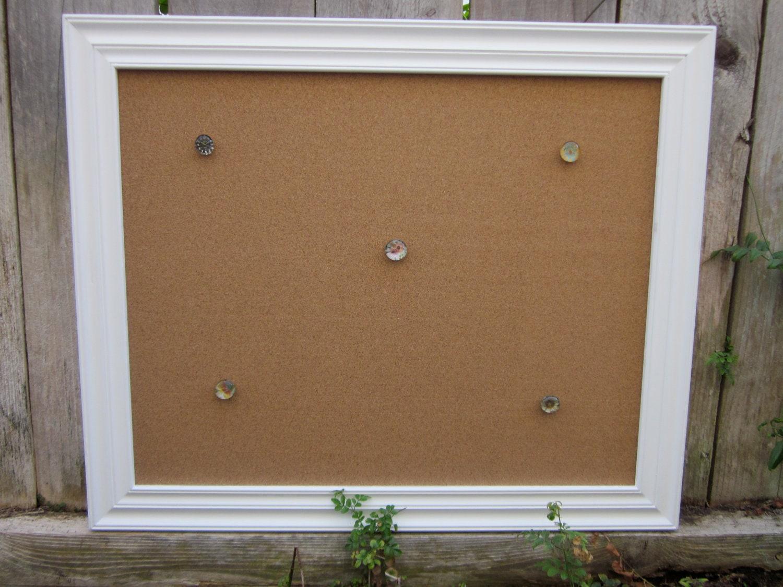 white framed cork board