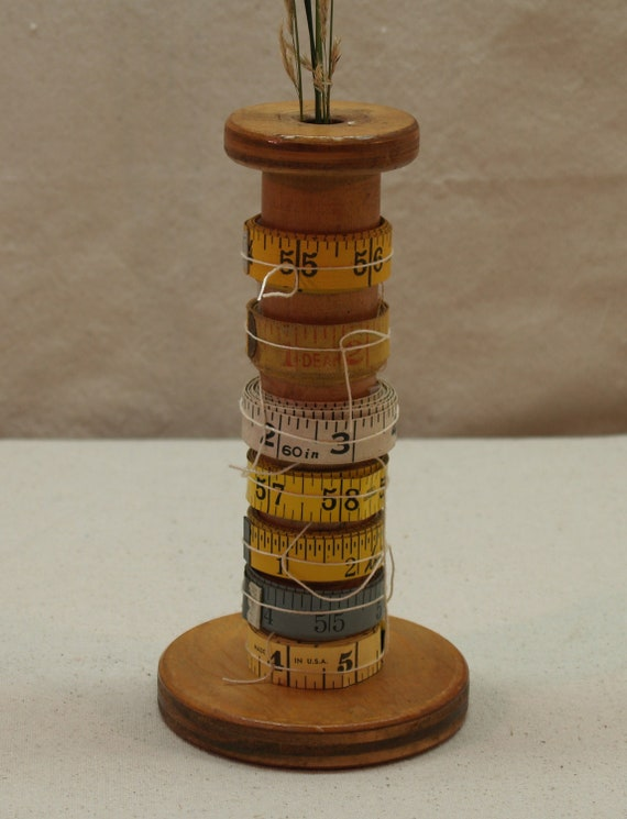 wooden spool with tape measures