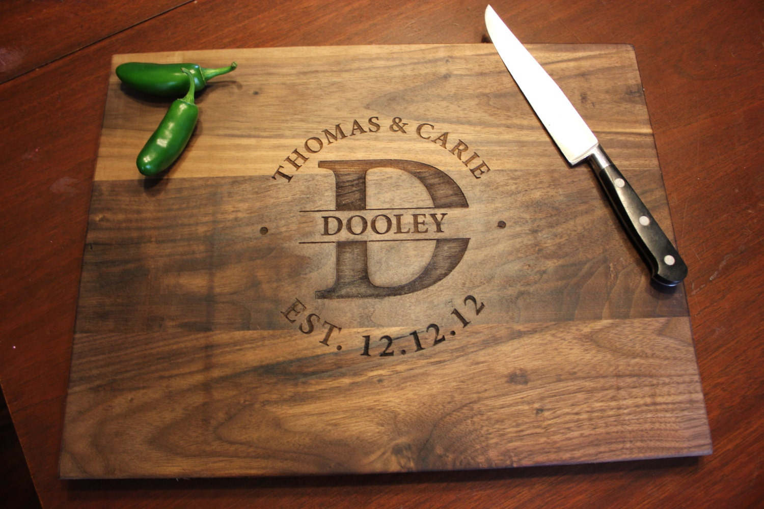 personalized engraved wood cutting board by damianswoodworks