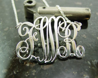 """monogram necklace  2"""" from side to side  1.75 top to bottom size,sterling silver.monogram. with a chain."""