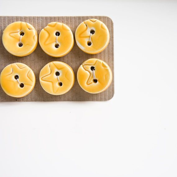 https://www.etsy.com/listing/105349531/ceramic-buttons-bright-yellow-handmade