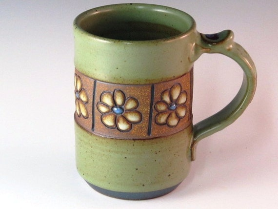 Mug With Flowers And Soft Green Glaze With Textured Handle