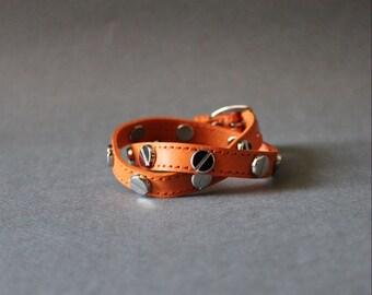 Screw Stud Ornament Leather Bracelet(Orange)