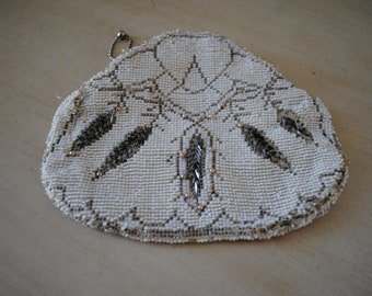 a vintage 60s beaded zipper case. pearl white with silver leaf detail.