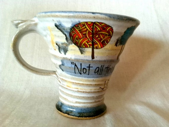 """J.R.R. Tolkien """"Not all those who wander are lost."""" Literary Quote Mug - Glazed, flared clay goblet - Cream and blue with trees"""
