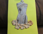 Victorian Style Tag with Floral  Design Decorating a Blank Notecard