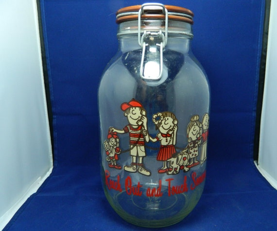 Large Vintage Reach Out and Touch Someone Glass Advertising Jar