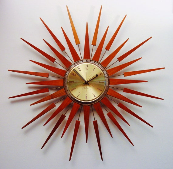 Mid-Century Modern Starburst Wall Clock by Seth Thomas, Starflower Design.  1960s.  Teak Darts and Arrows.
