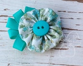 Forget Me Not yo-yo with teal grosgrain ribbon detail on alligator clip hair or clothing accessory
