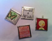 Your Pick - 1 Pendant Charm.  Snowman, butterfly Magyar, trust love believe, Make a Wish.  Pictures between 2 peices of glass and sautered.