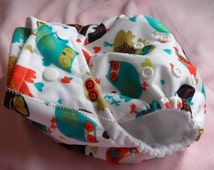 SassyCloth one size pocket diaper with retro owls PUL print. Made to order.