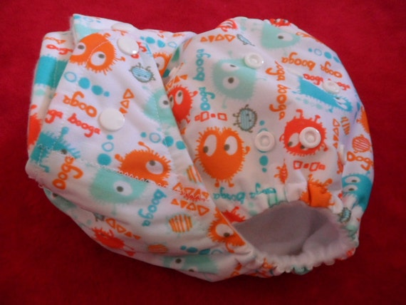 SassyCloth one size pocket diaper with guppy ooga booga PUL print. Ready to ship.