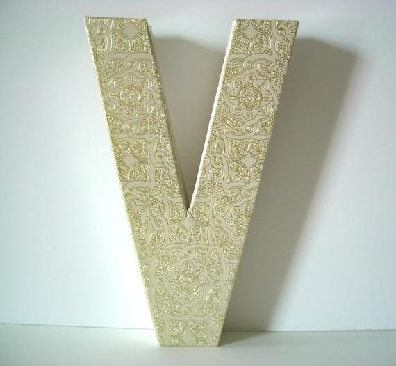 Letter V with Vintage Gold Design Paper