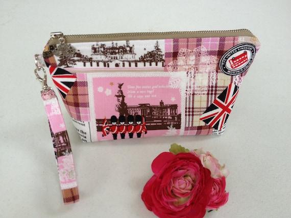 Handmade Makeup bag / detachable wristlet / mini purse : British theme double decker bus pink linen fabric