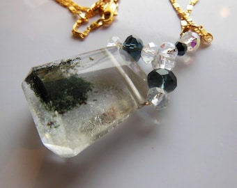 Phantom Quartz wrapped in gold on gold filed chain  339