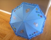 Light Blue parasol for Rain or Shine and a baby shower