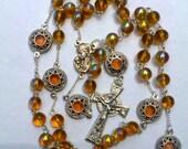 Rosary: amber yellow and stars