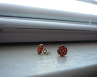 tiny orange and white polka dot posts