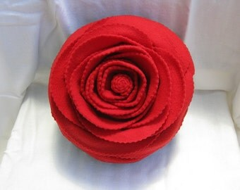 Beautiful Red Rose on a Dark Green Pillow