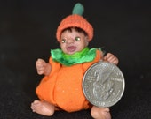 Dollhouse Doll - 1/12 Scale Miniature Infant Boy in Pumpkin Costume - Handmade OOAK Polymer Clay - Moveable Arms and Legs - Brenden Clarence