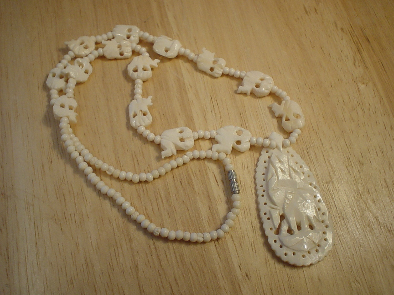 Vintage Faux Ivory Carved Elephant Necklace