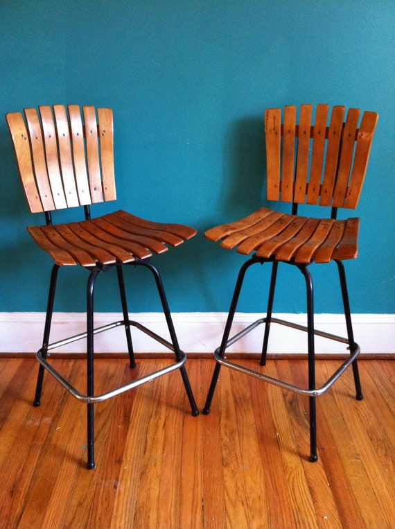 Two vintage industrial style swivel bar stools