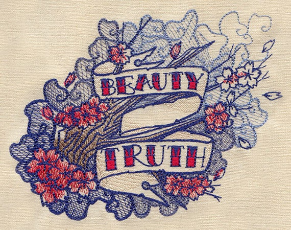 "Classic tattoo style - ""Beauty and Truth"" embroidered feeding bib."