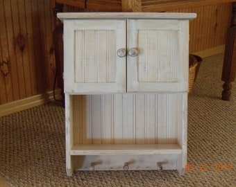 white cabinet w/shelf, dbl door and pegs
