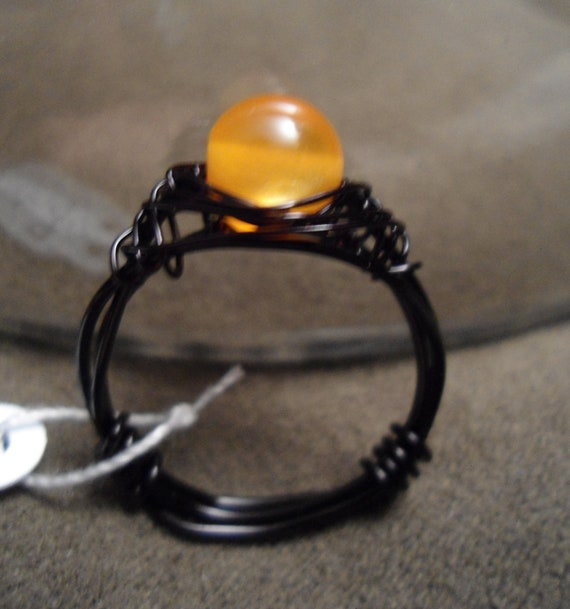 Orange and black wire wrapped ring