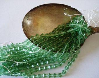 Czech Glass transparent peridot medium green Bicone Beads 6mm