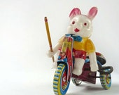 Celluloid Rabbit on Tin Tricycle, wind up toy Made in Japan 1950s
