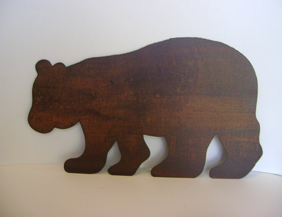 Metal Bear Wall Hanging, ready to hang with a natural rust finish and brush coated with polyurethane. Metal bear yard stake.