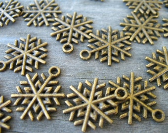 10 Bronze Snowflake Charms 19mm Antiqued Bronze