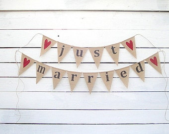 Just married burlap banner with red glittered hearts, lowercase