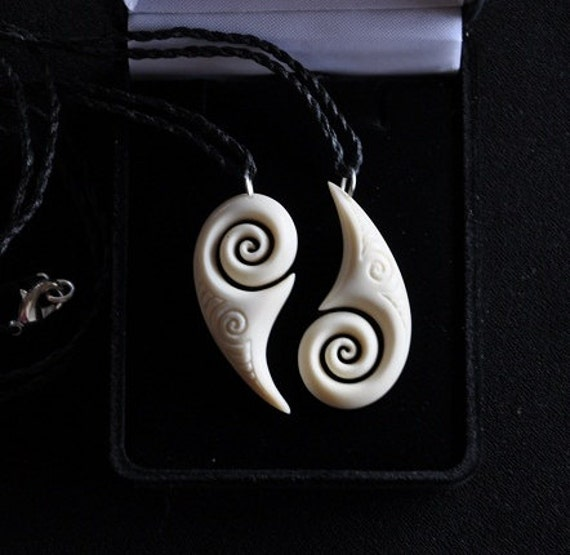 Union, Matching carvings in Bone symbolising two fitting together as one