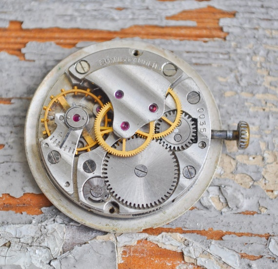 1 inch Vintage watch movement with dial.