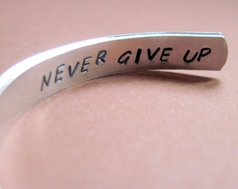 Inspirational Bracelet - Never Give Up - Hand Stamped Cuff in Aluminum, Golden Brass or Sterling Silver  - customizable