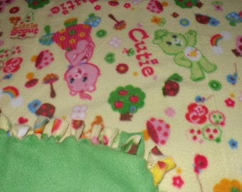 Fleece blanket, Care Bears  ,other side is all  medium green.. Will fit a gueen size bed