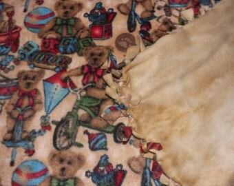 Fleece blanket,Teddy Bears with toys on it ,other side is all kahki tie dye