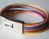 Colorful waxed cotton bracelet. Silver tone clasp. Made to order.