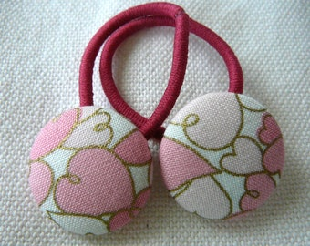 Pig tail elastics with fabric covered buttons