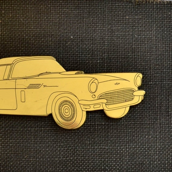vintage brass engraved car silhouette, an engravers salesman sample  offered by Elizabeth Rosen