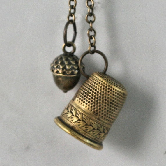Acorn and Thimble Kiss Peter Pan and Wendy  Necklace in Aged Brass